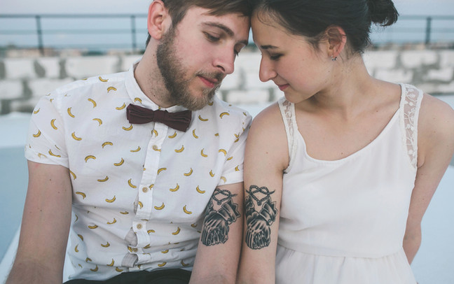 couple with matching arm tattoos
