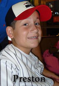 Preston Fisher with baseball cap on