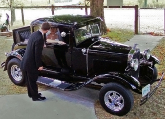 Wedding Couple in antique car at UHC