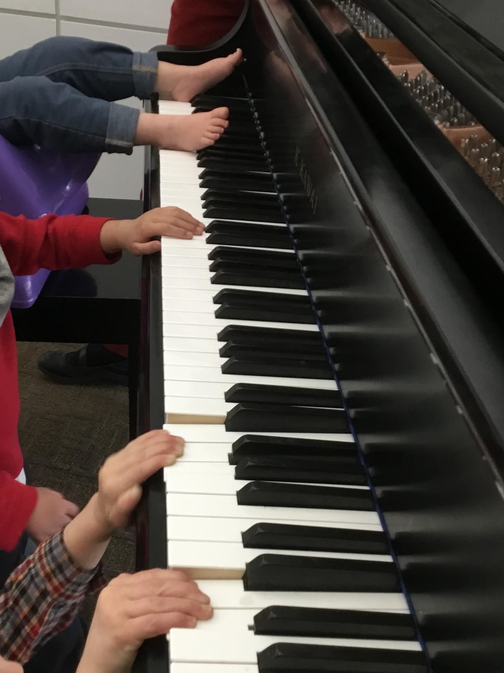 hands feet piano