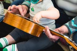 mom son ukulele