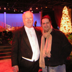 With Maestro Derric Johnson (Orchestrator/Conductor) after their Disney Candlelight Processional Show (December 2004)