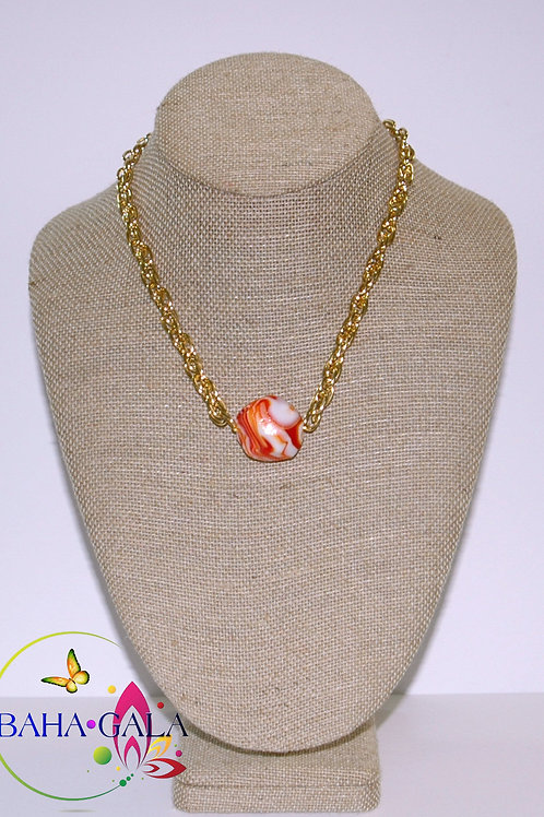Orange Swirl Agate Pendant Accented on Gold Stainless Steel Chain.