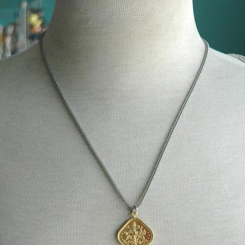 Gold Bahamian 0.15 Cents Pendant.