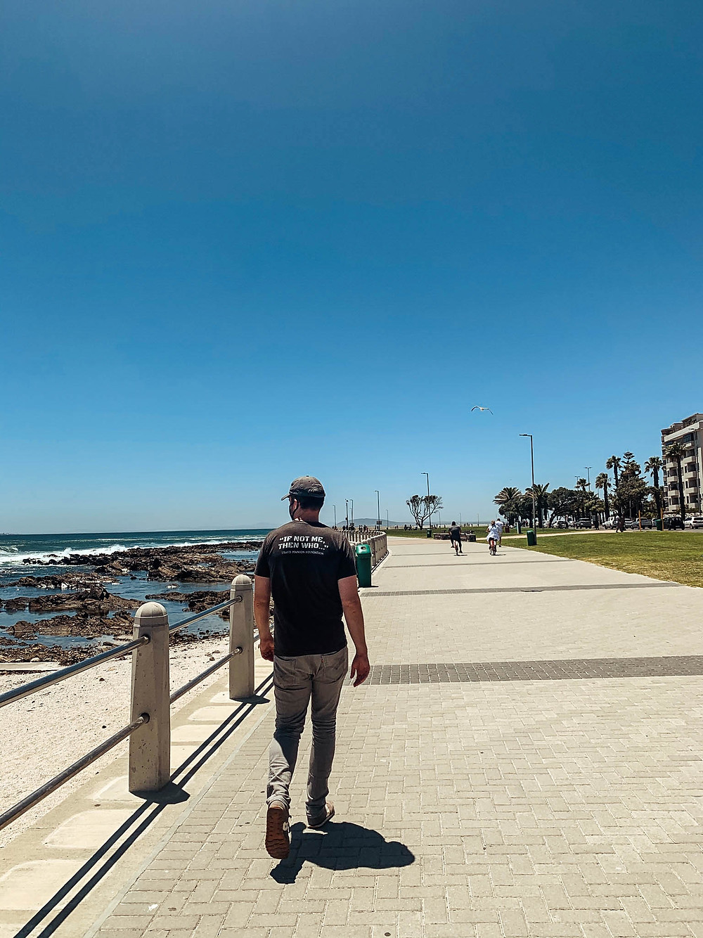Taking in the ocean views along the Sea Point Promenade