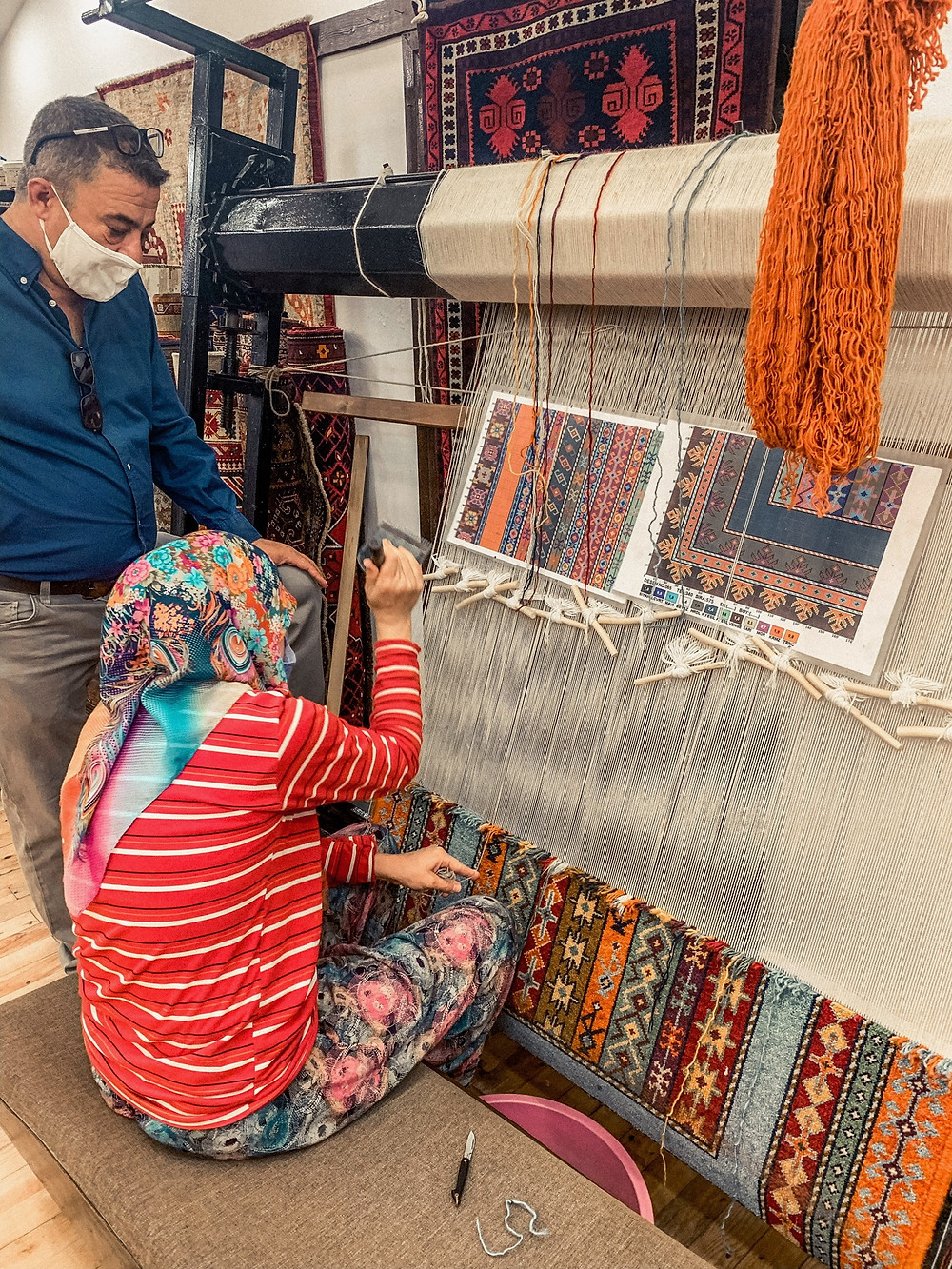 A master weaver creating a Turkish carpet, one knot at a time