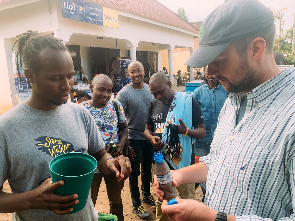 Sharing a jug of mbege