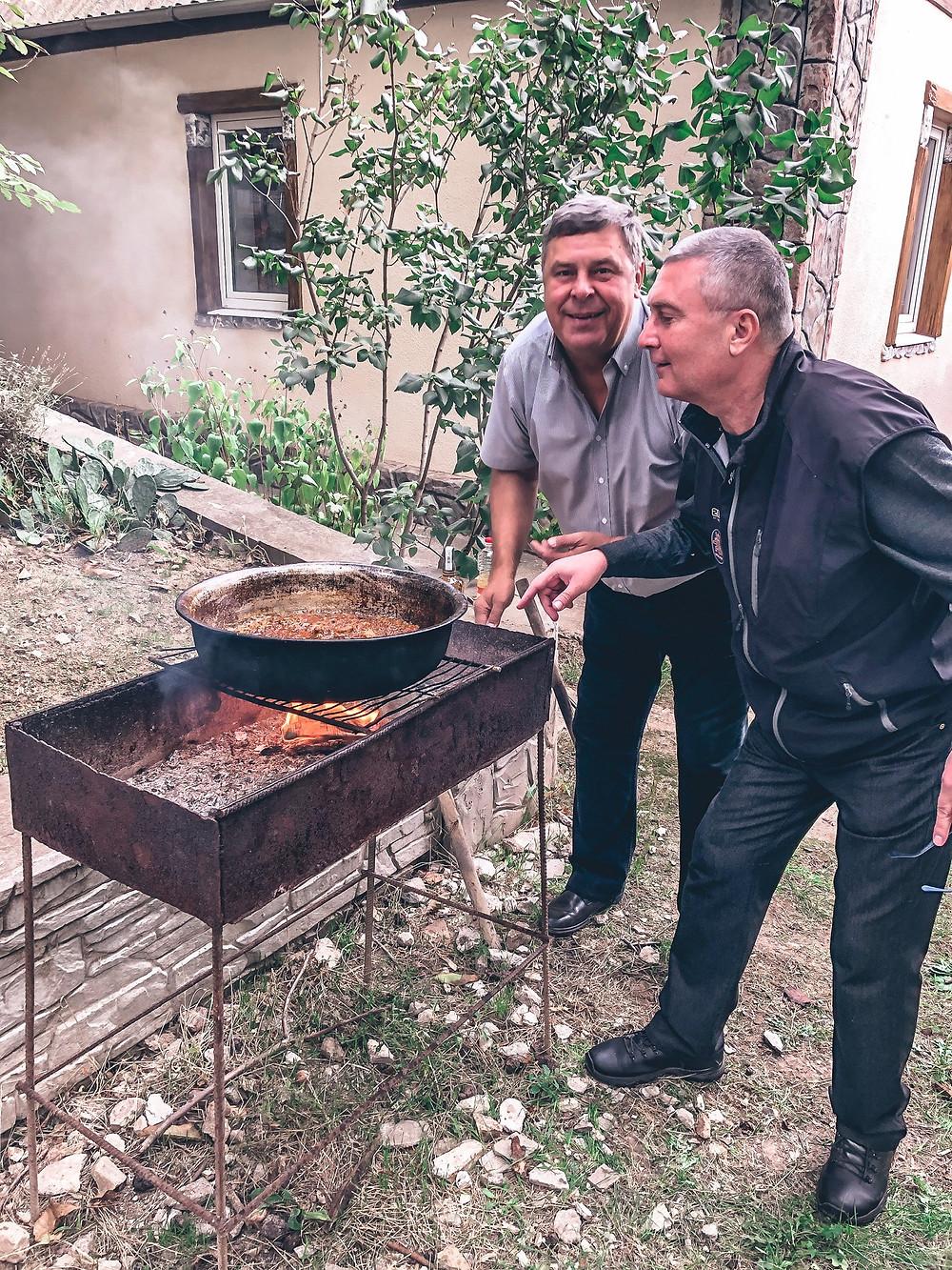 """Action shot - Dyada Oleg and Jenna's dad watching the pilaf """"na mangalye"""""""
