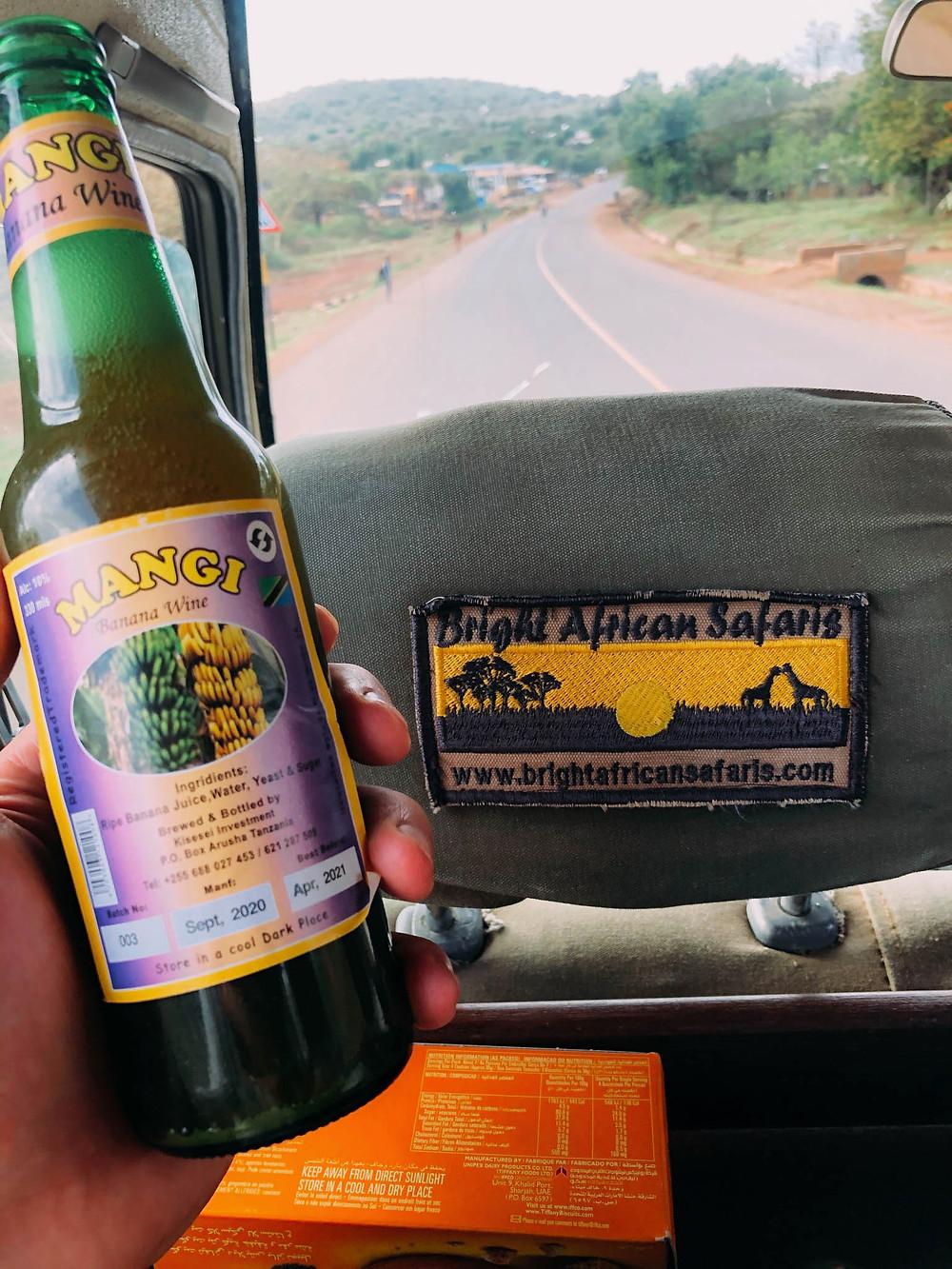 Enjoying some delicious banana wine on the way to Ngorongoro