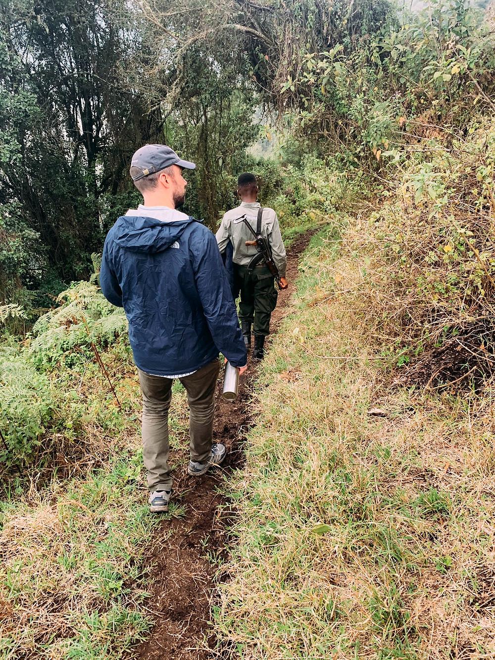 Descending into Empekaai Crater - armed ranger a necessary precaution