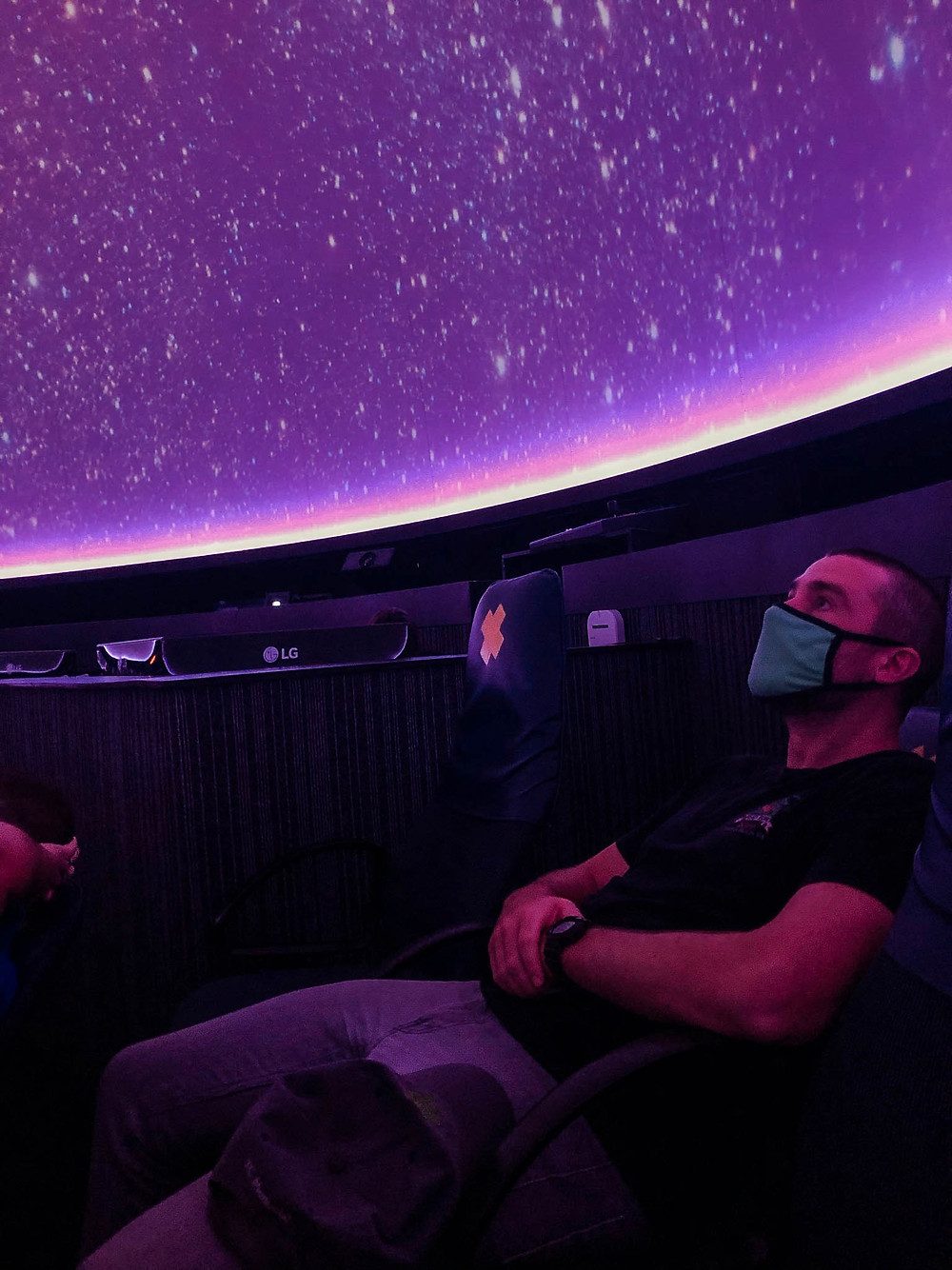 Taking in an awesome show at the planetarium...