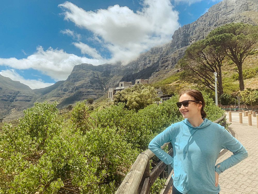 At the base of Table Mountain - welcome center and bottom of the cable car in the background