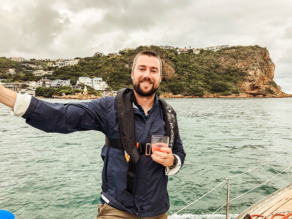 Sailing out through the Knysna Heads - eastern head in the background