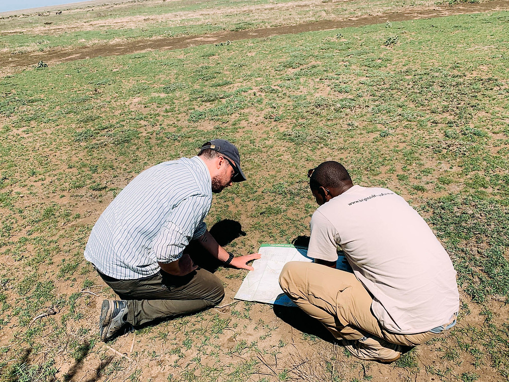 """""""Action shot"""" on Ndutu - Salim explaining to Chipp how not to get lost!"""