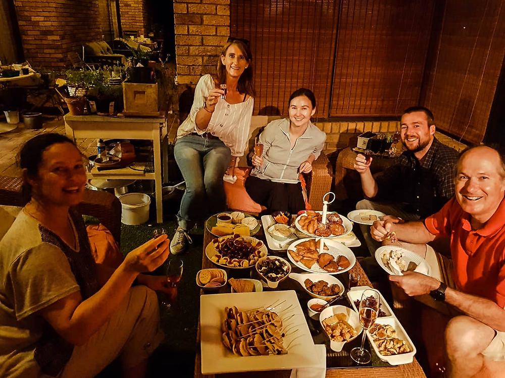 Enjoying an incredible array of snacks and wine with Natasha, Marleen, and Chris