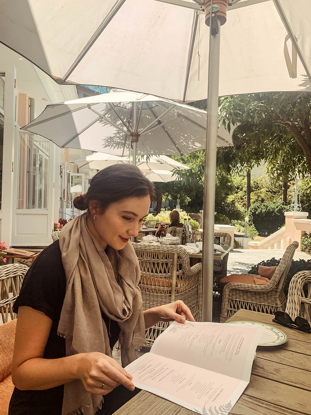 Perusing the tea menu at the Mount Nelson