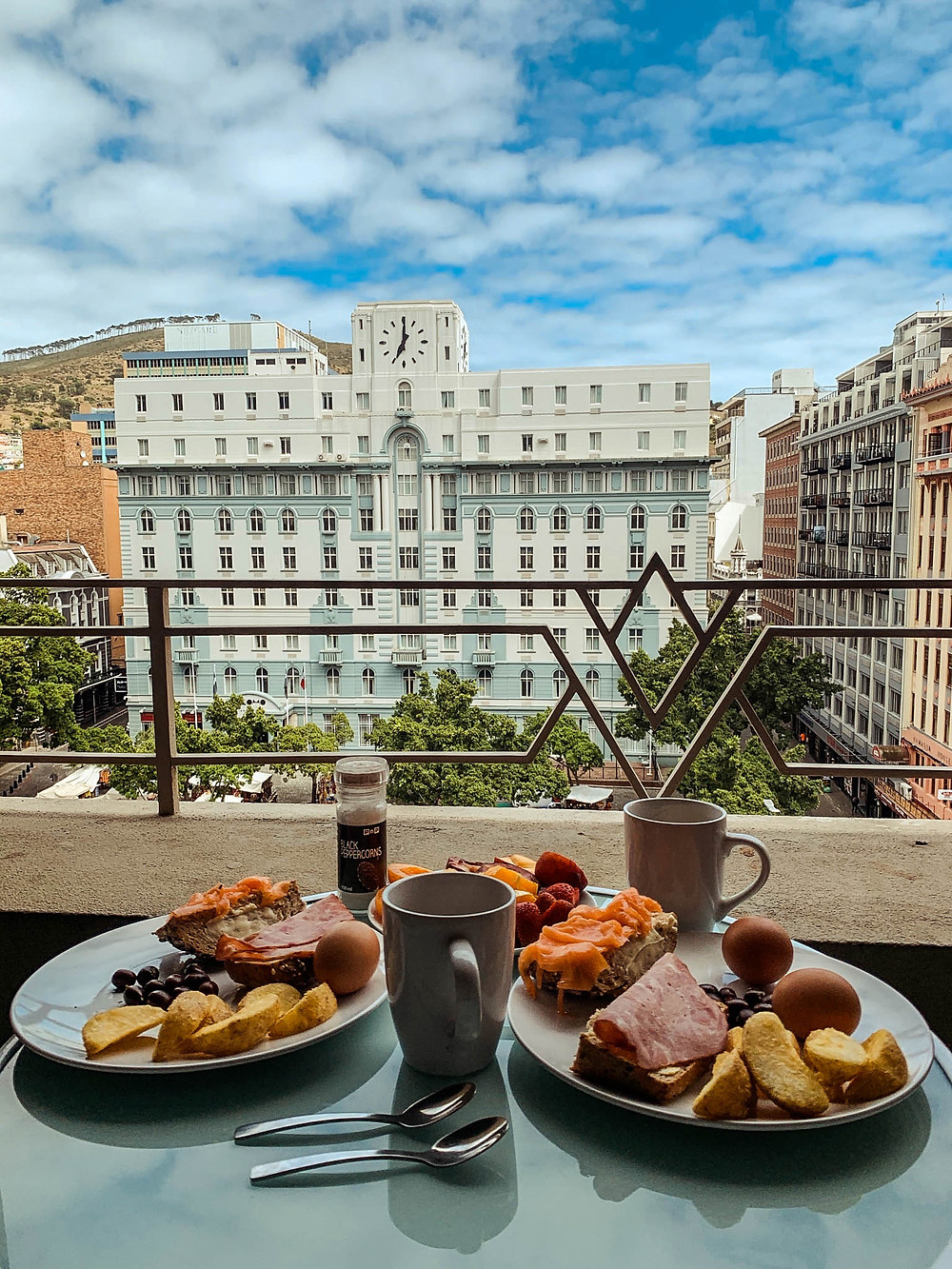 Breakfast on our apartment's balcony overlooking Greenmarket Square