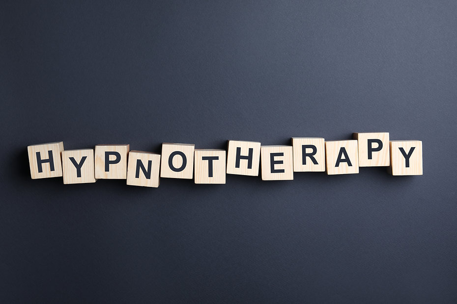 Wooden blocks with word HYPNOTHERAPY on