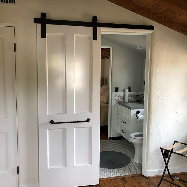 Remodeled bathroom with barn door in Montecito