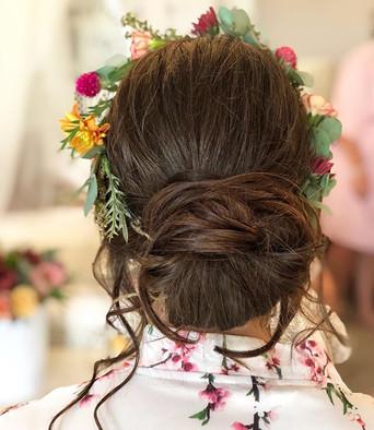 Soft romantic chignon bun for bridesmaid
