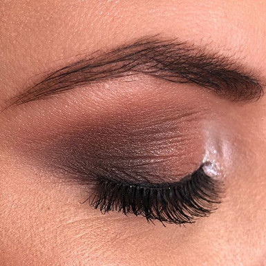 A natural brow with a Soft smoked out ey