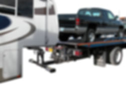 Tow truck loaded with pickup truck pulling fifth wheel using Collins fifth wheel lift hitch
