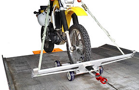 Collins Carrier Dolly loading motorcycle onto tow truck bed