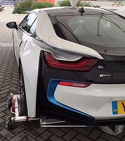 BMW hybrid or electric vehicle loaded on set of Collins Carrier Dollies