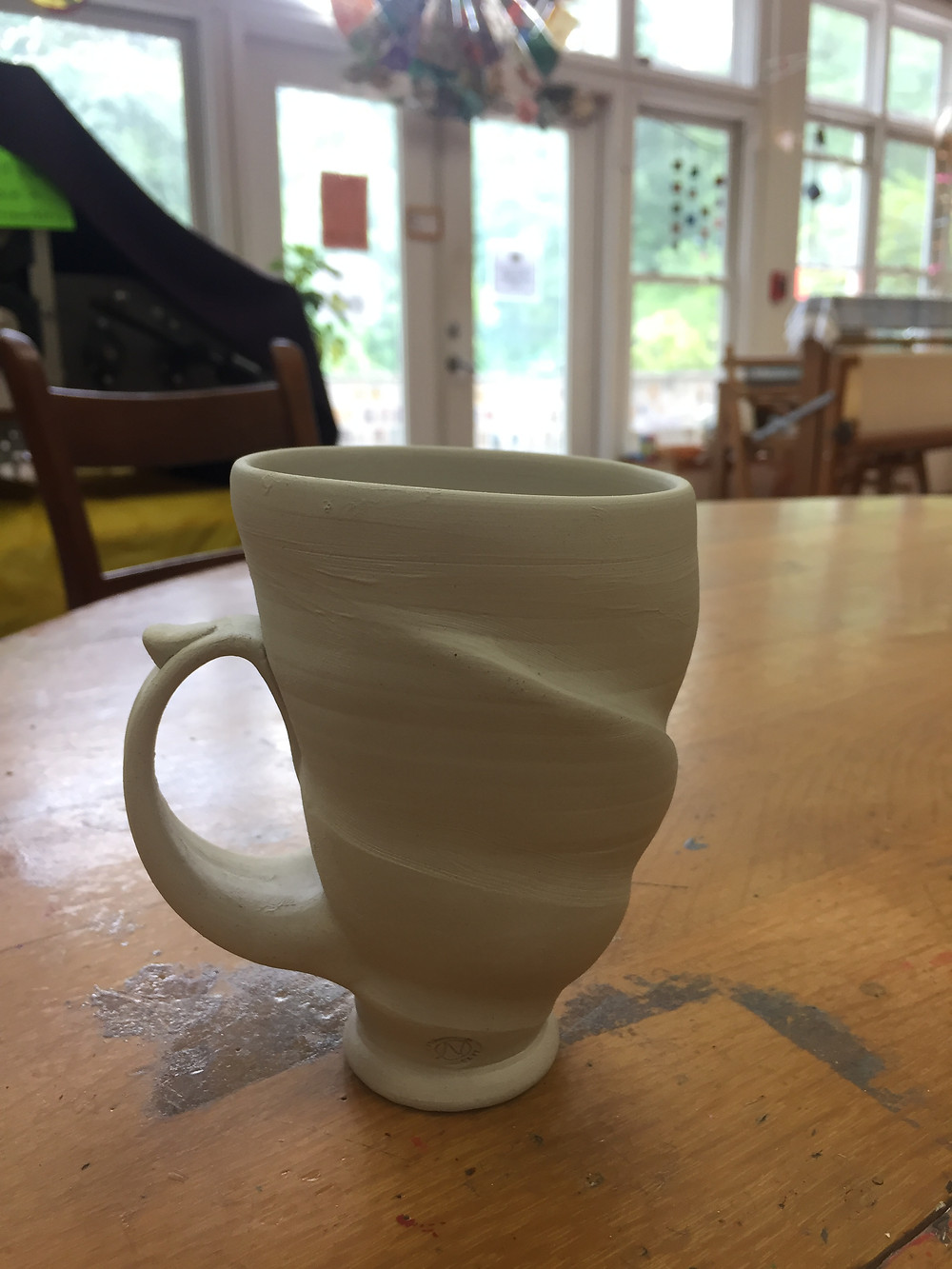 Fluid organic spiral cup.