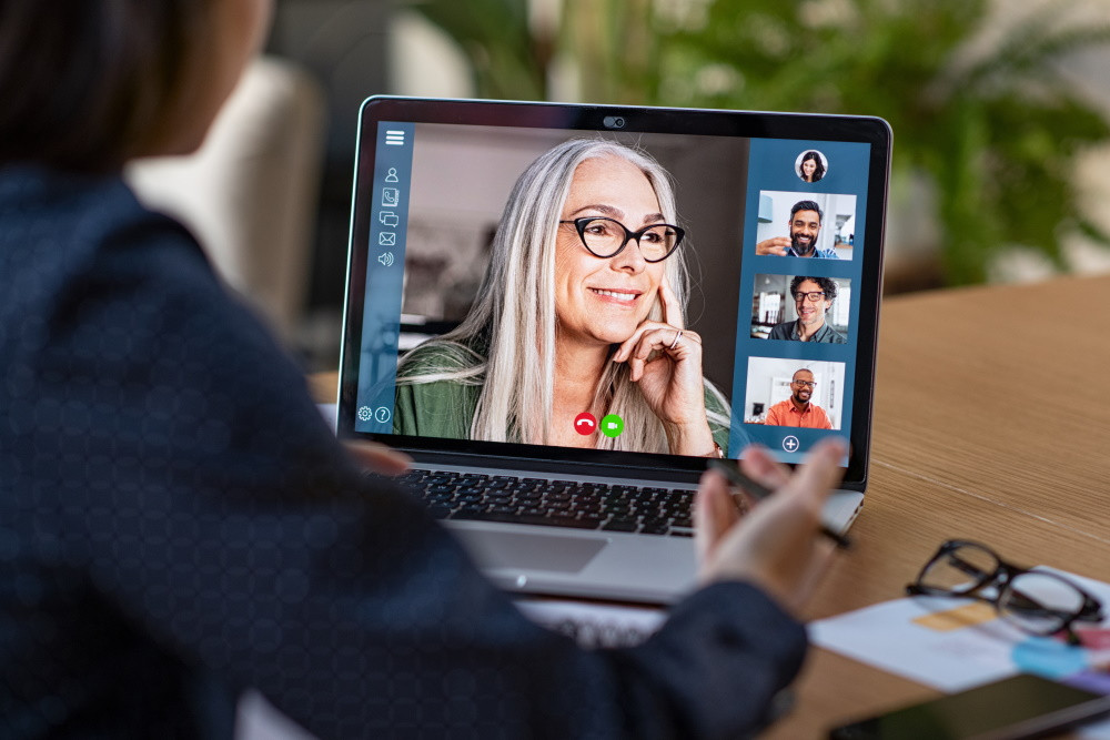 senior woman on group video conferencing screen