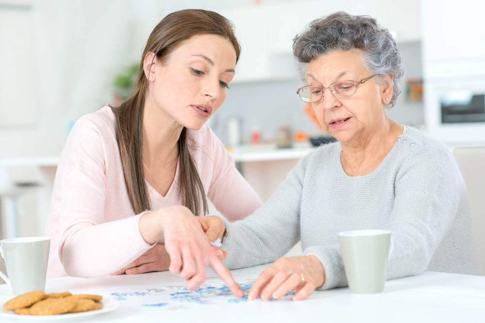 Adult daughter and her mother reviewing cost of assisted living facility