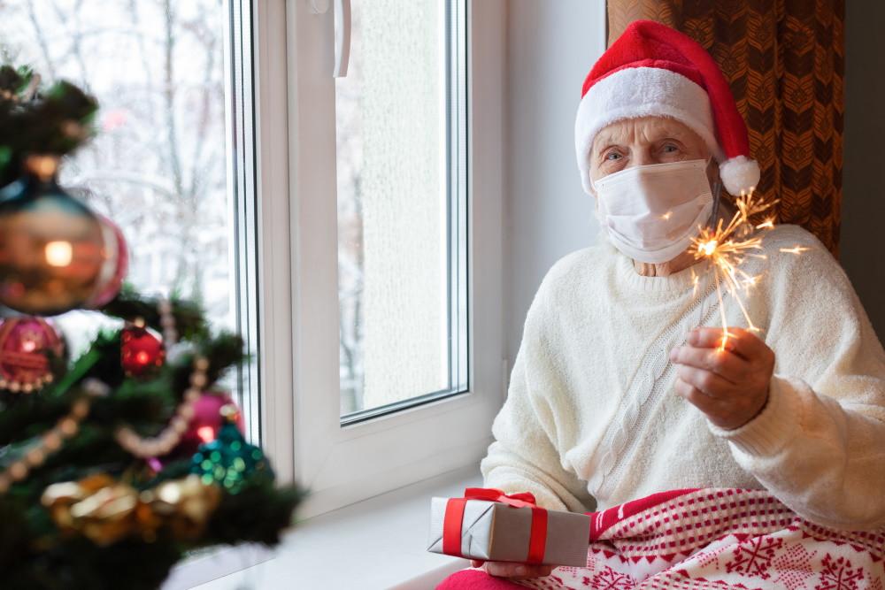 senior living community resident celebrating the holidays during COVID