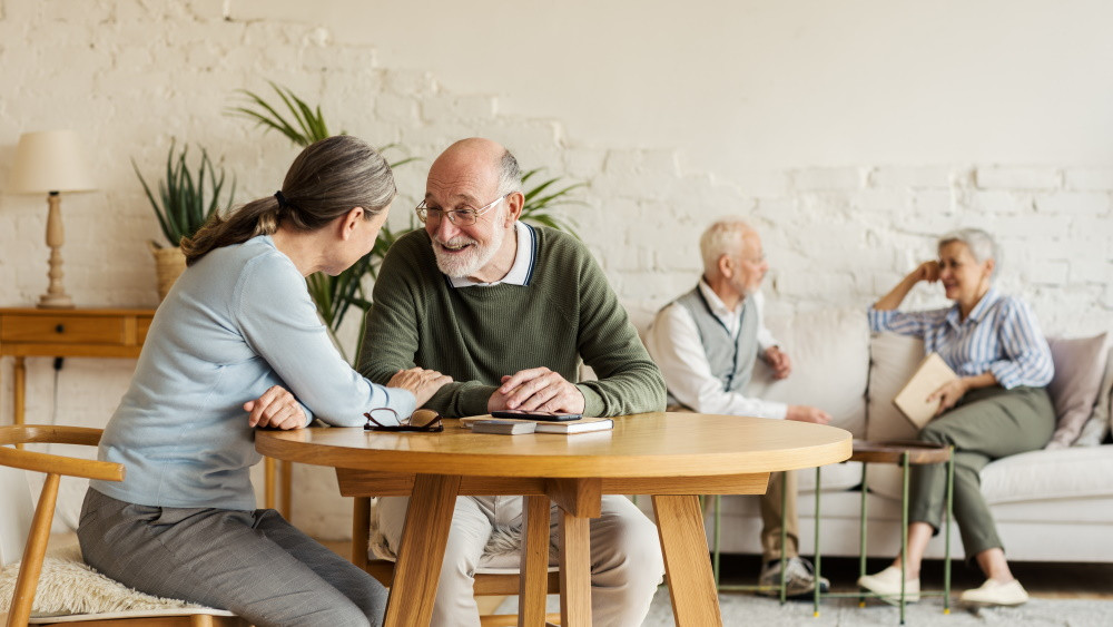 senior living community residents sitting at table