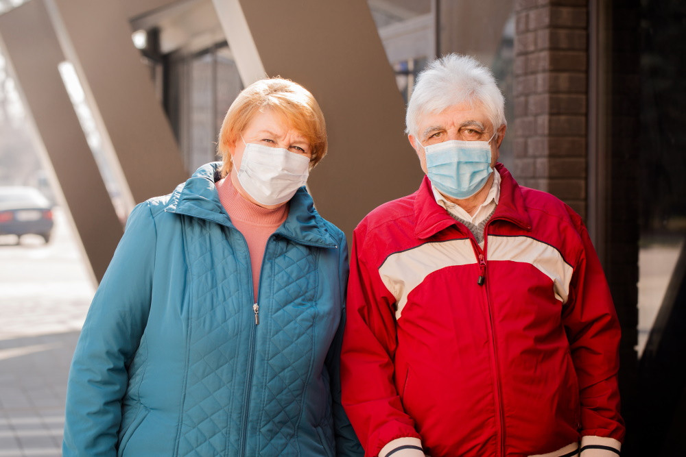 senior citizens wearing face masks outside a building