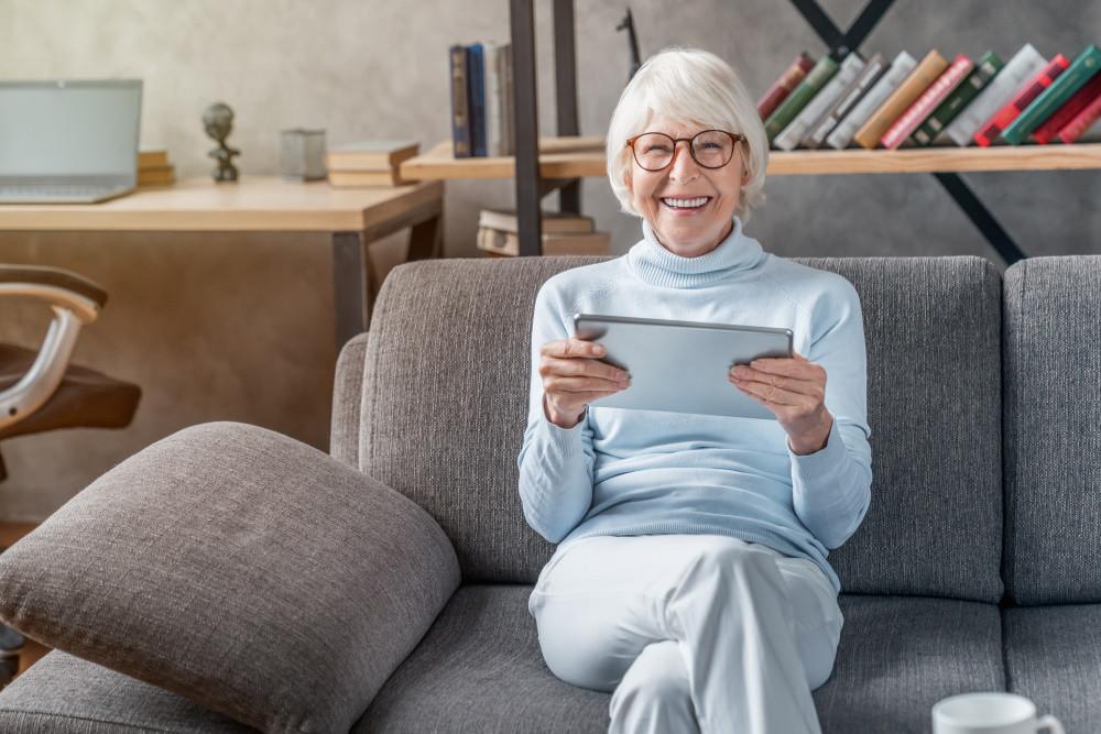 senior living resident holding ipad