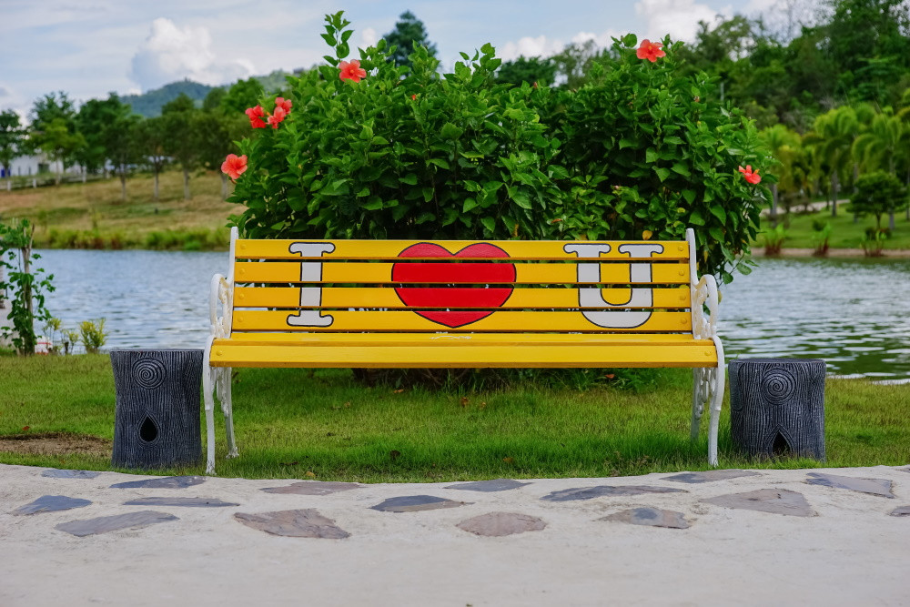 "wooden bench with ""I Heart You"" painted on it"