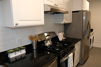 Newly Renovated kitchen, with granite countertops, a gas stove and stainless steel appliances.