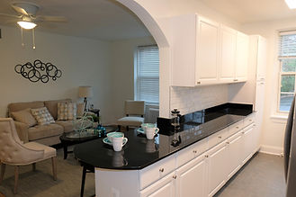 Granite counter top kitchen with an open breakfast bar looking into the large living room.