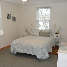 Hardwood bedroom, at Lyon Village Apartments.
