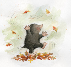 A happy mole playing in leaves