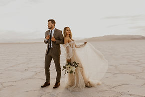 elopement couple standing at the boneville salt flats in Utah