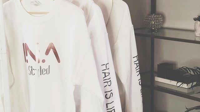 white crew neck Ina styled logo sweater