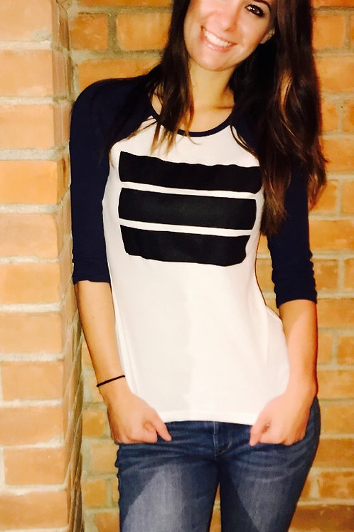 ladies white baseball tee with blue sleeves with black logo
