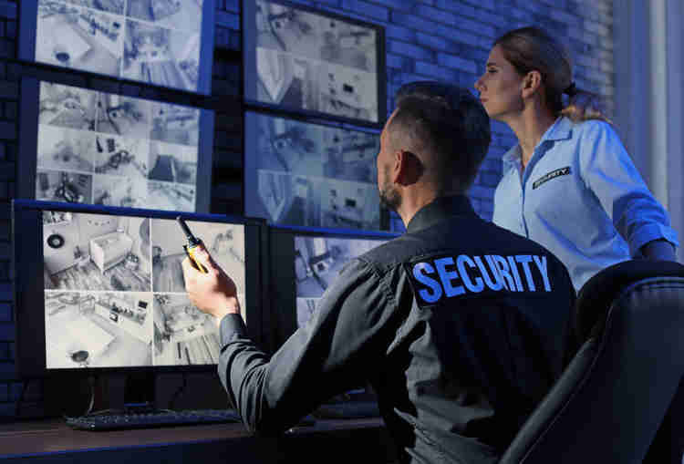 Security guards monitoring CCTV