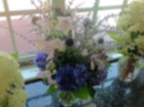 Vase of hydrangea, thistle and campanula
