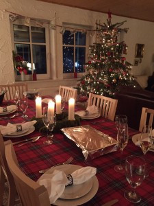 My daughter's table set for Christmas Eve dinner, 2015. No paper plates this time!