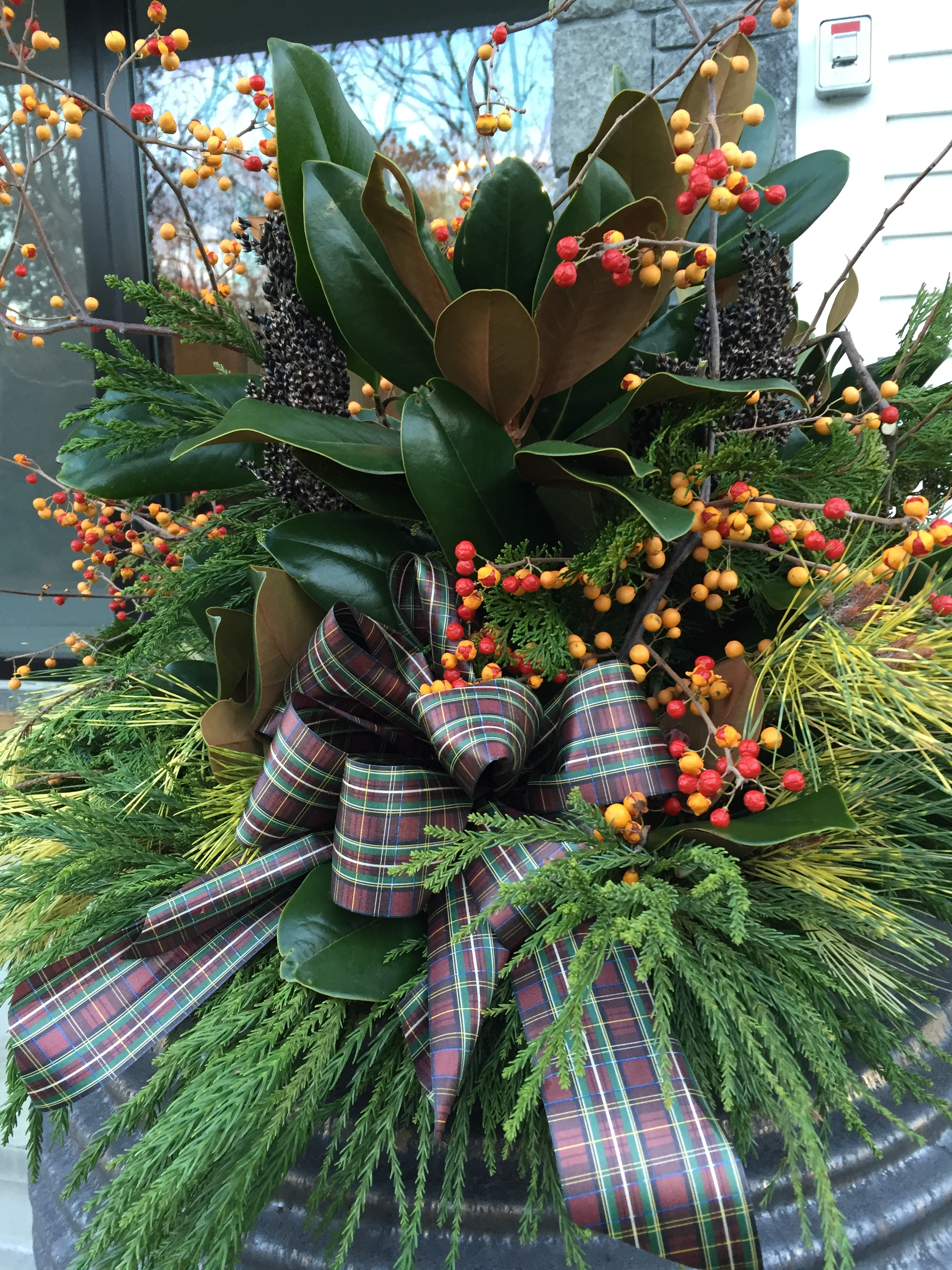 Urn with greenery, berries & tartan
