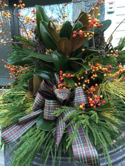 Urn with greenery, berries & tartan
