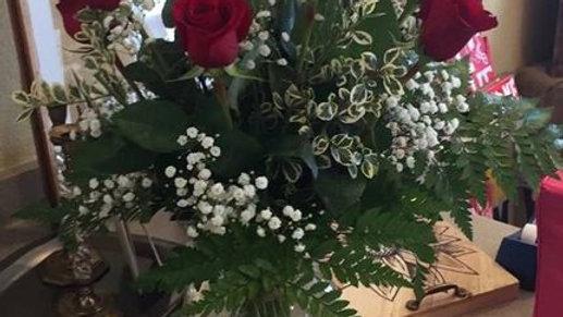 "Dozen Vased Roses ""non Holiday "" price"