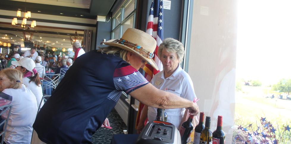 IMG_1288 sue choosing wine.JPG